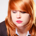 Portrait sad unhappy businesswoman closeup face redhaired girl of of on grey gray stress in work studio shot Royalty Free Stock Image