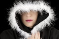 Portrait of sad woman in black cape artistic conversion with white feather Stock Photos