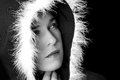 Portrait of sad woman in black cape black and white with feather Royalty Free Stock Photo