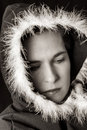 Portrait of sad woman in black cape black and white with feather Royalty Free Stock Images