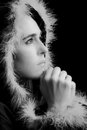 Portrait of sad woman in black cape praying feathered rim artistic conversion Stock Photos