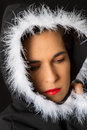 Portrait of sad woman in black cape with white feather Royalty Free Stock Photo