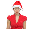Portrait of sad young woman in Santa hat Stock Photography