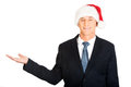 Portrait of santa businessman with welcome gesture Royalty Free Stock Photo