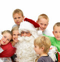 Portrait of  Santa Claus with kids isolated Stock Photo