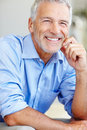 Portrait of satisfied mature business man smiling Stock Photos