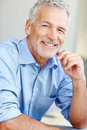 Portrait of satisfied mature business man smiling Royalty Free Stock Image