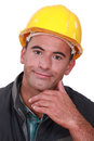 Portrait of a satisfied tradesman touching his chin Royalty Free Stock Photography