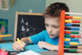Portrait of a school boy working on math homework Royalty Free Stock Photo