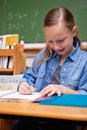 Portrait of a schoolgirl writing Royalty Free Stock Photo