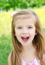 Portrait of screaming little girl in a meadow outdoor Royalty Free Stock Photo