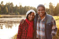 Portrait Of Senior African American Couple Walking By Lake Royalty Free Stock Photo