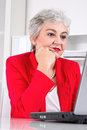 Portrait of senior business woman with laptop on workplace Stock Photography