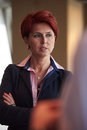 Portrait of senior business woman at office red hairstyle corporate interior Stock Photos