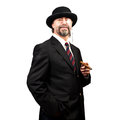 Portrait of a senior businessman in hat and glasses holding cigar Stock Photography