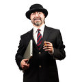 Portrait of a senior businessman holding notebook and cigar and smiling Stock Photography
