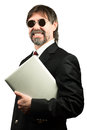 Portrait of a senior businessman in sunglasses holding notebook and smiling Royalty Free Stock Image