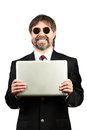 Portrait of a senior businessman in sunglasses holding notebook and smiling Royalty Free Stock Images