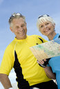 Portrait Of A Senior Couple Holding Map Stock Images