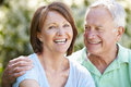 Portrait of senior couple sitting in summer garden together Royalty Free Stock Photos