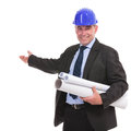 Portrait of a senior engineer presenting something and smiling isolated on white background Stock Photo