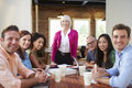 Portrait of senior female boss with team in meeting Royalty Free Stock Photos