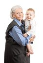 Portrait of a senior grandmother holding grandson Stock Photo