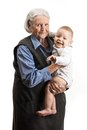 Portrait of a senior grandmother holding grandson over white Royalty Free Stock Photos