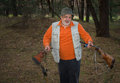 Portrait of senior hunter with two rifles in pine forest outdoor Royalty Free Stock Photos