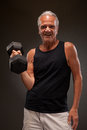 Portrait of a senior man exercising with dumbbell Royalty Free Stock Photo
