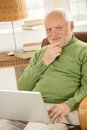 Portrait of senior man with laptop computer Royalty Free Stock Photo