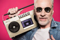 Portrait of senior man in sunglasses holding tape recorder Royalty Free Stock Photo