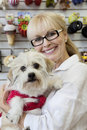 Portrait of senior pet owner shop with dog Royalty Free Stock Images