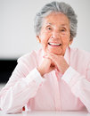 Portrait of an senior woman a beautiful smiling at home Stock Photo