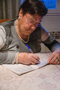Portrait of senior woman with crossword puzzle Royalty Free Stock Photo