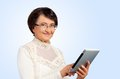 Portrait of senior woman with digital tablet Stock Image