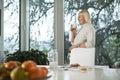 Portrait of senior woman having breakfast caucasian drinking fresh milk for at home Stock Image