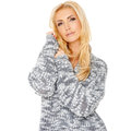 Portrait of a sensual blond beautiful woman cuddling into warm knitted top standing with her head tilted looking at the camera Royalty Free Stock Photo