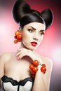 Portrait of sensual woman model with luxury makeup tomatoes and beauty hair beautiful fresh tomato make up hair style Royalty Free Stock Photo