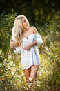 Portrait of a sensual young blonde female on field Royalty Free Stock Photos
