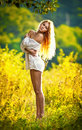 Portrait of a sensual young blonde female on field Stock Photo
