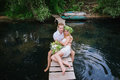 Portrait of a sensual young couple hugging on a wooden bridge background blue water lifestyle love romance relationships Stock Photos
