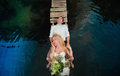 Portrait of a sensual young couple hugging on a wooden bridge background blue water lifestyle love romance relationships Royalty Free Stock Photography
