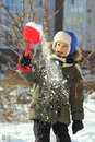 Portrait of seven year old caucasian happy boy playing with first winter snow Royalty Free Stock Photo