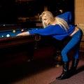 Portrait of sexual blonde woman with cue plays billliard billiard sport concept pool billiard game american pool billiard Royalty Free Stock Photo