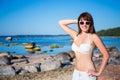 Portrait of sexy beautiful woman in bikini on the beach posing Royalty Free Stock Photography
