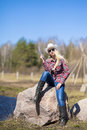 Portrait of Sexy Blond Cowgirl with Gun outside Royalty Free Stock Photo