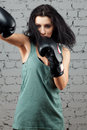 Portrait of sexy boxer girl with gloves on hands Royalty Free Stock Photo