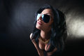 Portrait of sexy brunette in glasses swag girl with beautiful breasts Stock Photos