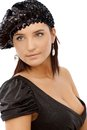 Portrait of sexy woman in sequin hat black party dress with hot cleavage and looking away Stock Images
